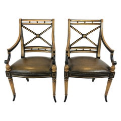 Glamorous Pair of Regency Black and Gilded Armchairs with Leather Seats