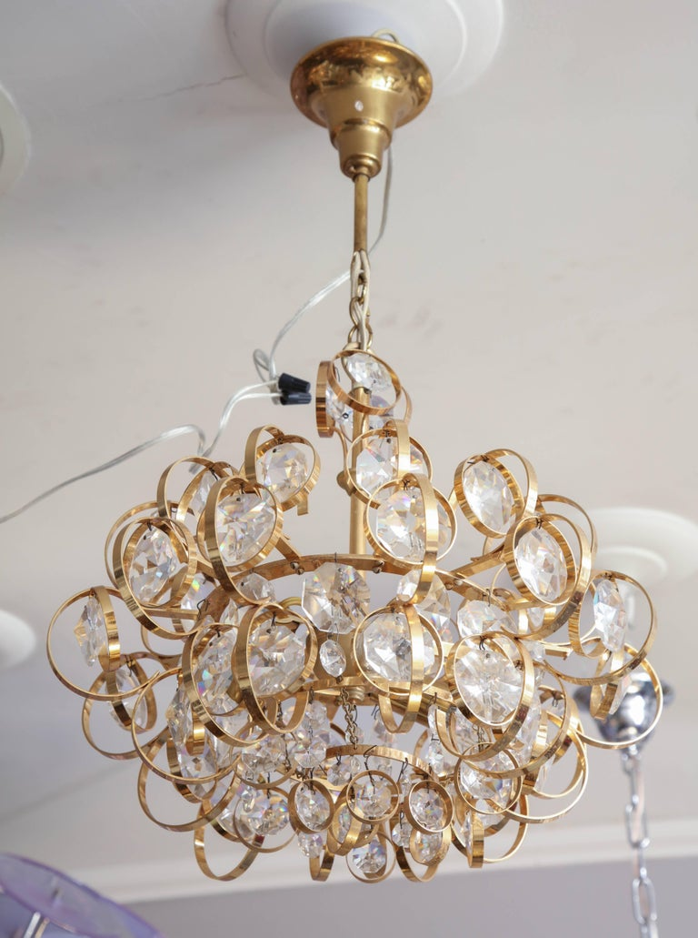 Glamorous petite vintage Palwa chandelier. It has 3 candelabra sockets and is in excellent condition with minimum wear that is consistent with its age and use.