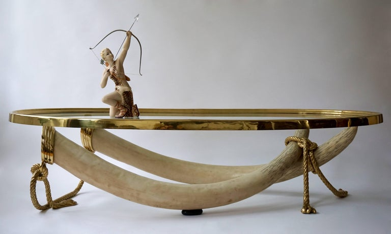 Large and heavy cast resin tusks with solid brass