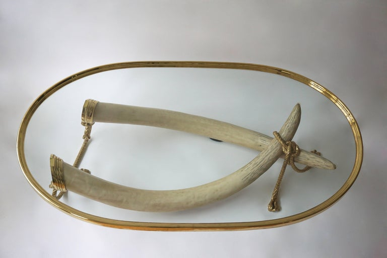 Glass and Brass Elephant Tusk Base Coffee Table by Valenti, 1970s In Good Condition For Sale In Antwerp, BE