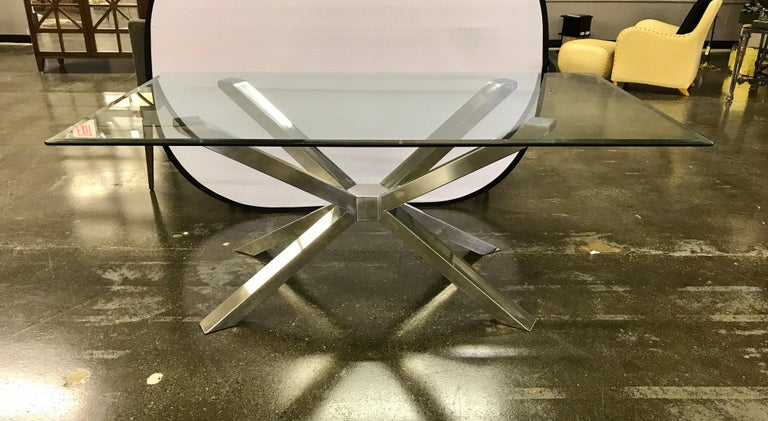 Exceptional mid century modern style  glass dining table with a sculptural chrome base and four Calligaris matching chairs in dark olive upholstery. The table dimensions are below and the chair dimensions are 19 x 21 x 34 tall with a seat height of