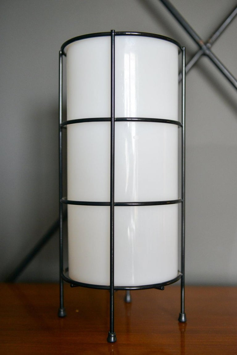 Rare glass and iron case study lamp by Sidecar for Artemide, New York. Excellent vintage condition with beautiful opaque milk glass shade and iron cage frame. Delicate feet and original switch.  Measures 12
