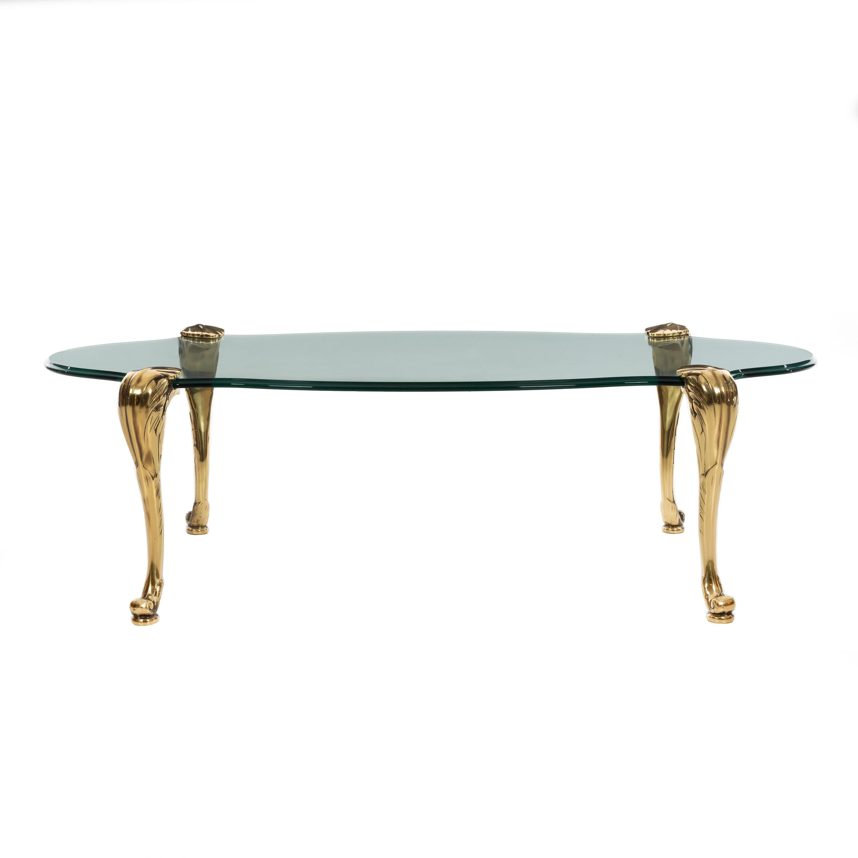 Glass Coffee Table with Ornamental Saber Legs