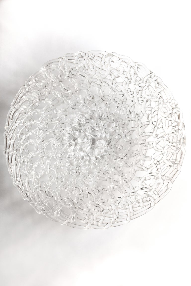 Is a centerpiece, Is a fruit holder,  Is a single piece of glass, cast, hand embroidered,  It's an invention, it's a sculpture, takes the light and breaks it into a thousand pieces, it is an object that furnishes captivating the eyes.