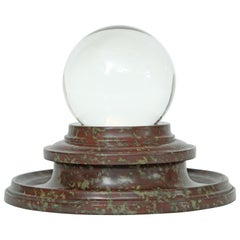 Crystal Orb Elevated by a Turned Marble Stand