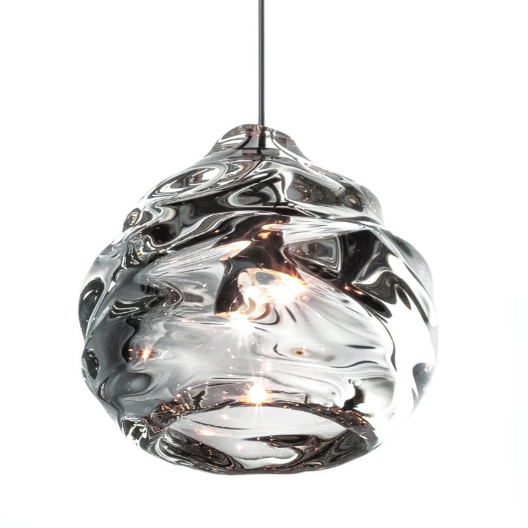 Clear Happy Pendant Light - canopy included -  Hand Blown Glass Pendant Light Various Colors / Finishes Available  These works play with the reflective and malleable qualities of glass. This line consists of heavy thick-walled pieces, which are hand