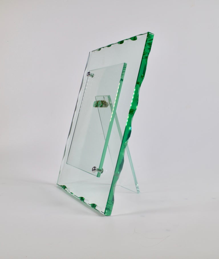 A beautiful cut glass photoframe by Fontana Arte from the 1940s with an indented polished green edge. The front piece is neatly secured with two nickel plated round button screws.   27.5 x 21