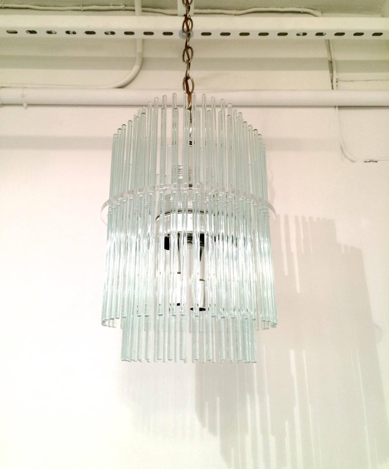 Two tier glass rod and Lucite chandelier by Gaetano Sciolari for Lightolier. Eight chrome sockets and fittings. Rewired.