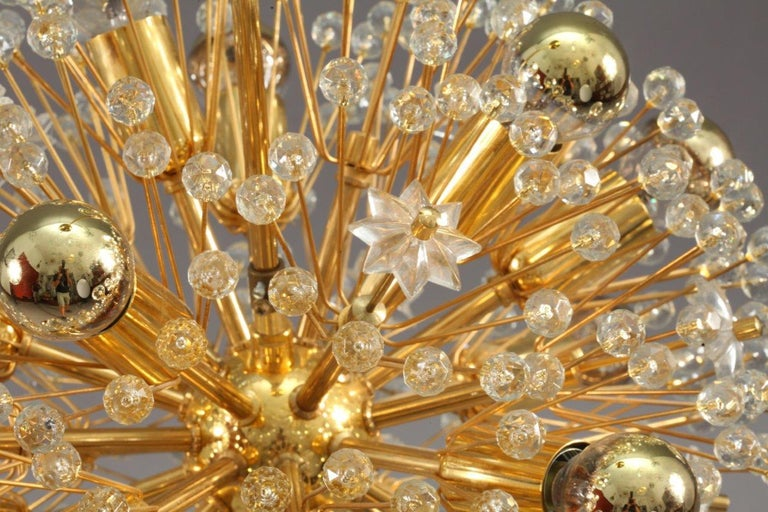 Glass and brass pendant by Emil Stejnar for Nikoll, Austria, 1960s.  The large amount of crystals gives a wonderful light effect. The lamps holds 17 E14 light bulbs. Total drop can be adjusted to your requirements.   Please note that we can