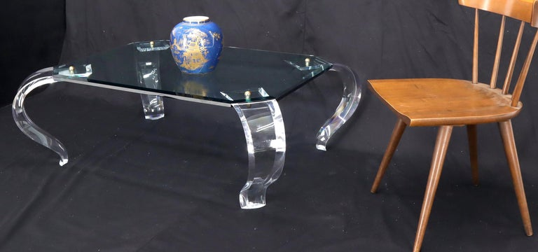 Mid-Century Modern glass top carved Lucite cabriole leg rectangular coffee table. The legs are secured and brass ball finial decorative fastener and the whole table easily comes apart.