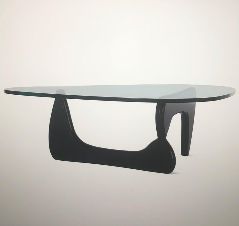 Glass top coffee table by Isamu Noguchi for Herman Miller, circa 2000s. 