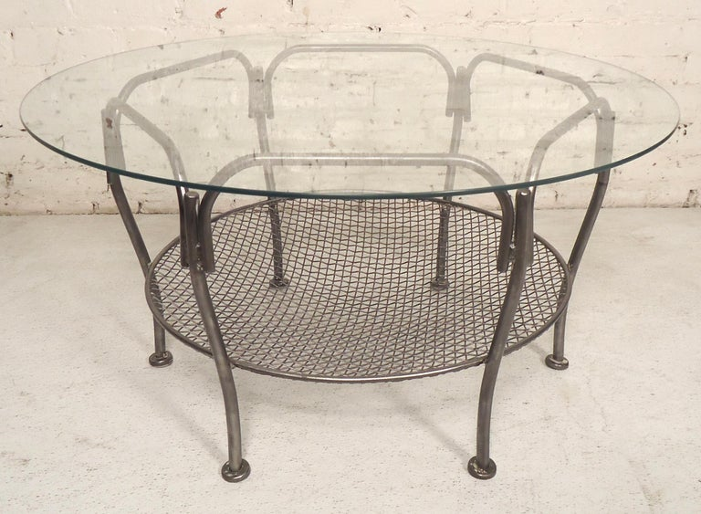 Round table with metal base that has been restored to a bare metal style finish. Base can support a larger glass top.