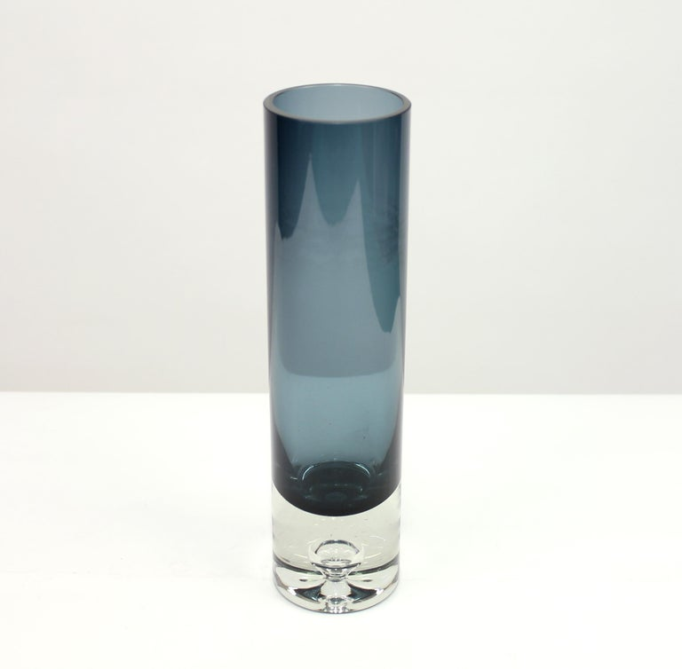 Blue glass vase, model 3586 by Finnish design legend Tapio Wirkkala for Iittala. Beautiful drop decoration inside the foot. Some ware on the inside. Not visible when filled with water. Signed underneath.