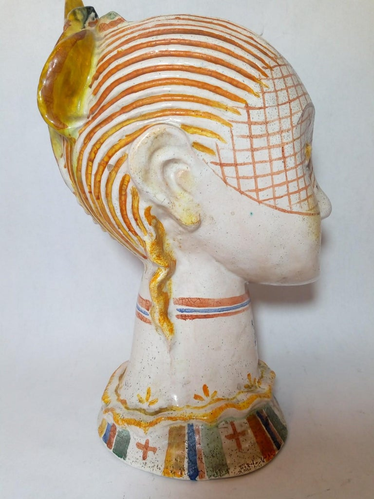 Beautiful ceramic head of a woman with painted veil, white base with colored glaze, attributed to Vally Wieselthier from the