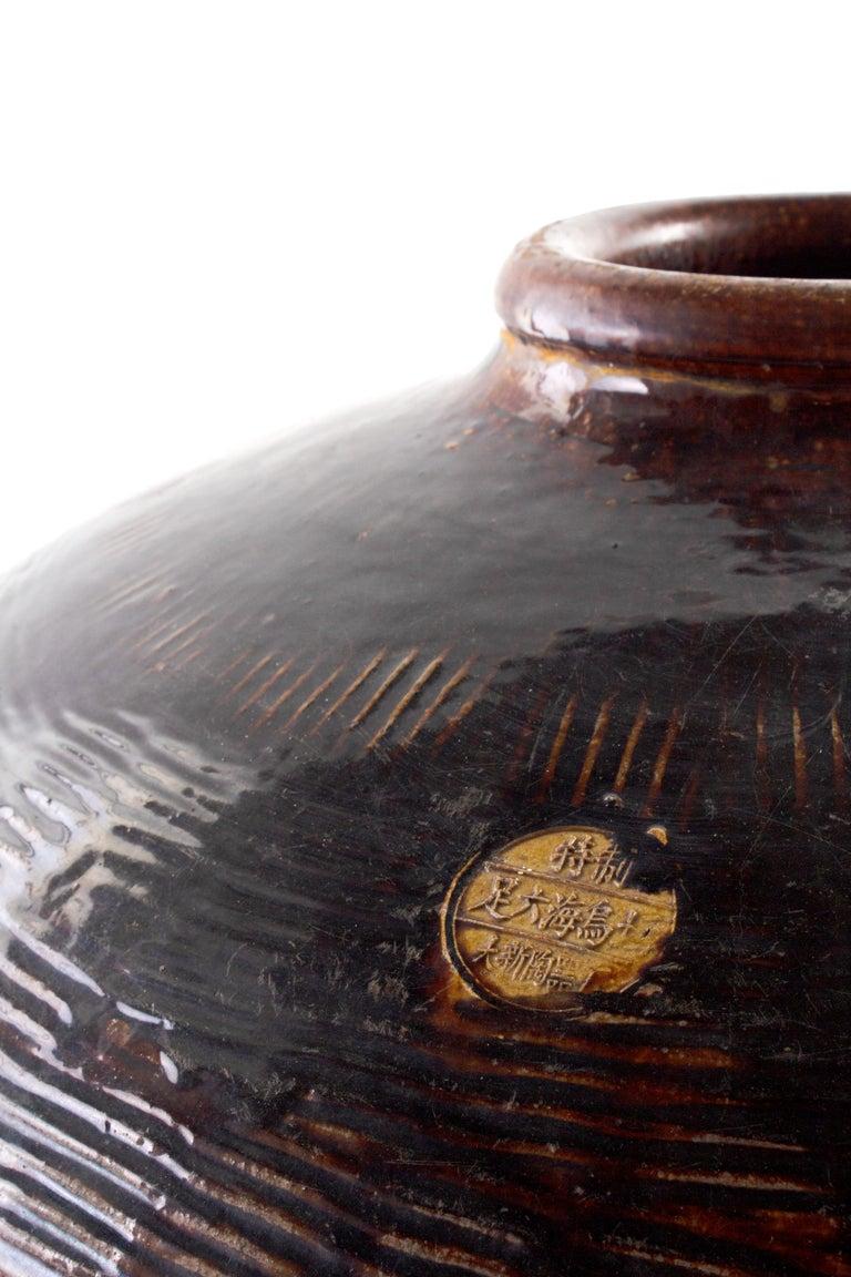 Glazed vintage terracotta storage jar.
