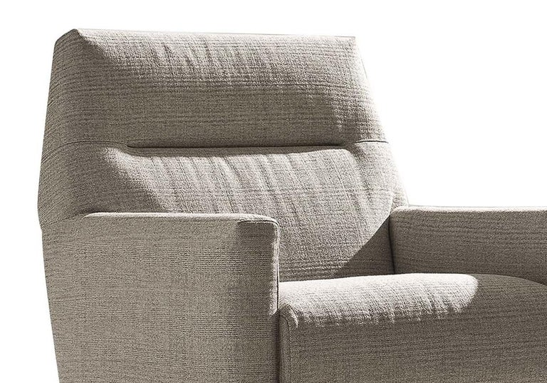 Showcased in a traditional-style living room, this armchair will be an elegant and comfortable addition to any decor. Evoking the clean lines of mid-century design, this piece features a slightly tilted back with a distinctive horizontal seam in the