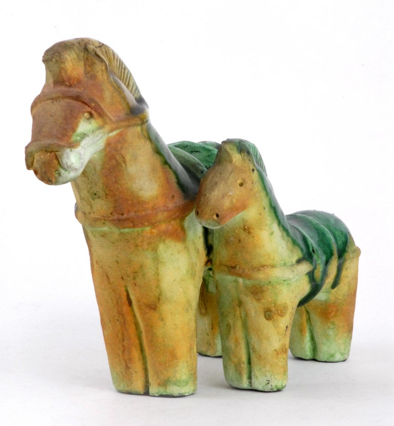 A very good double horse sculpture with shiny green glazed saddles and typical matt glaze finished lower sections and head and front. Unmarked.