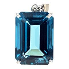 Glittering 32 Carat Blue Topaz Sterling Silver Pendant