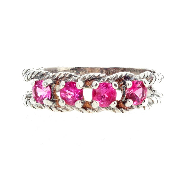 Four glittering super brilliant natural Pink Spinel - 3.5 mm round - .15 carats each - are set in this interesting lovely sterling silver ring size 7 sizable.  More from jeweler by putting Gemjunky into your 1stdibs search bar.