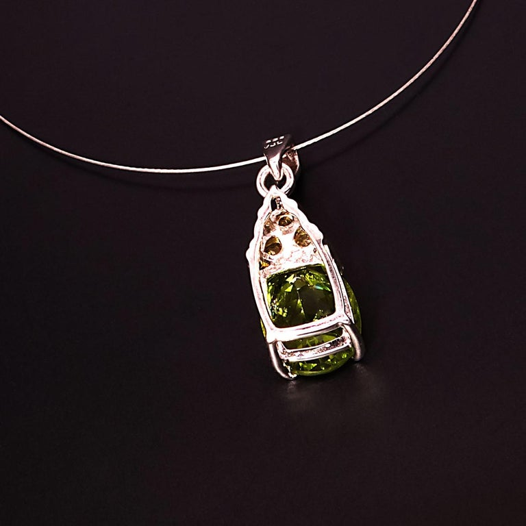 Oval Cut Glittering, Green Oval Peridot Pendant with Yellow Sapphire Accents  For Sale