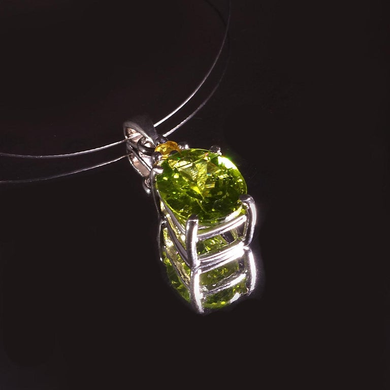 Glittering, Green Oval Peridot Pendant with Yellow Sapphire Accents  In New Condition For Sale In Tuxedo Park, NY