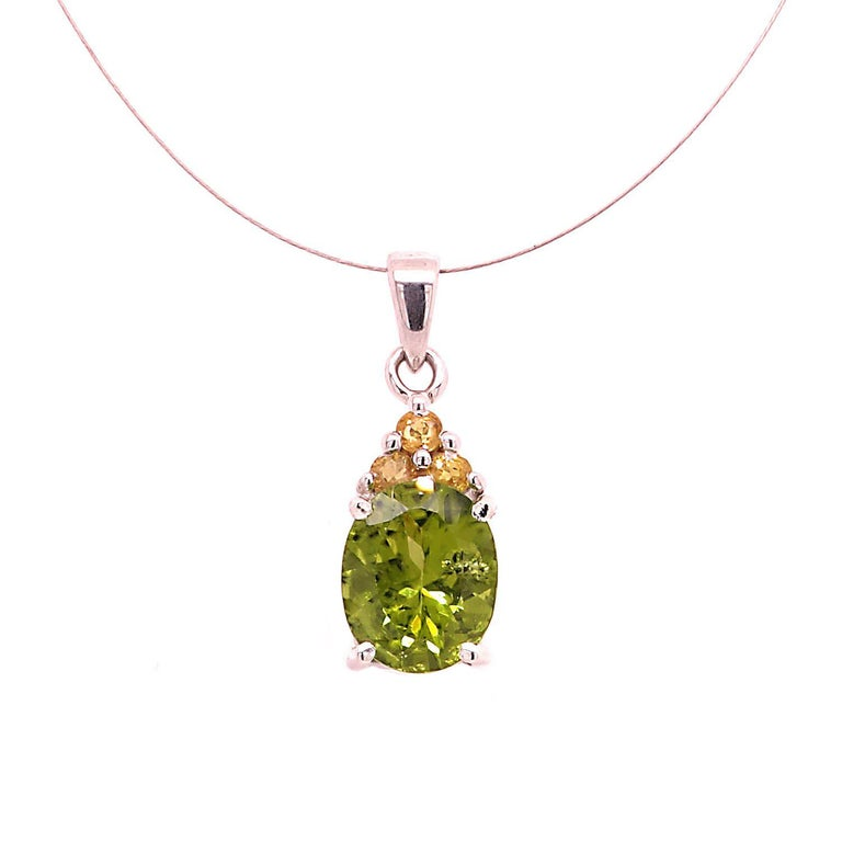 Glittering, Green Oval Peridot Pendant with Yellow Sapphire Accents  For Sale