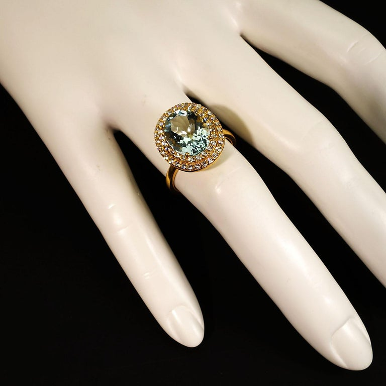 Oval Cut Glittering oval Aquamarine with Zircon Halo Cocktail Ring For Sale