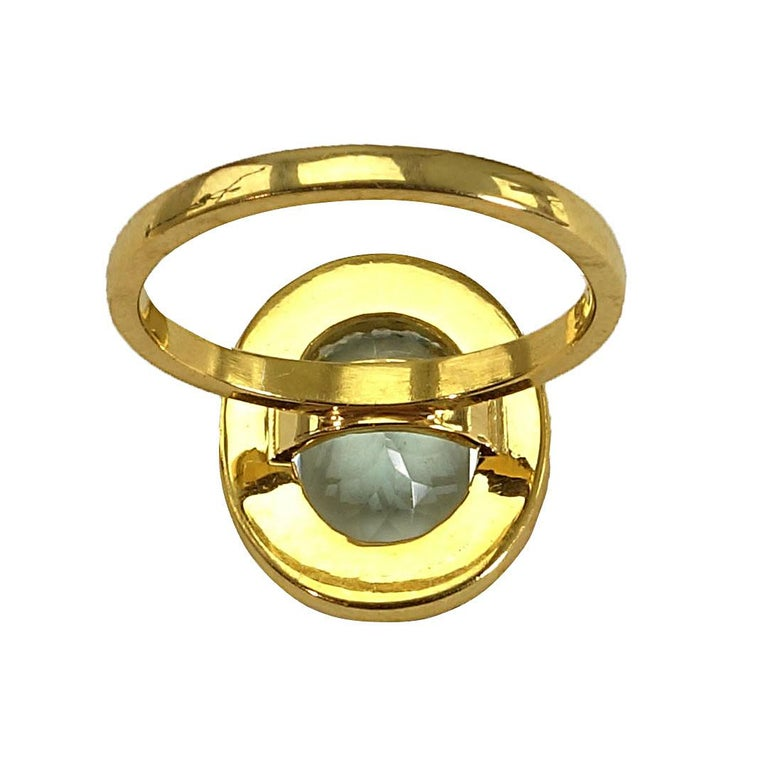 Glittering oval Aquamarine with Zircon Halo Cocktail Ring For Sale 2