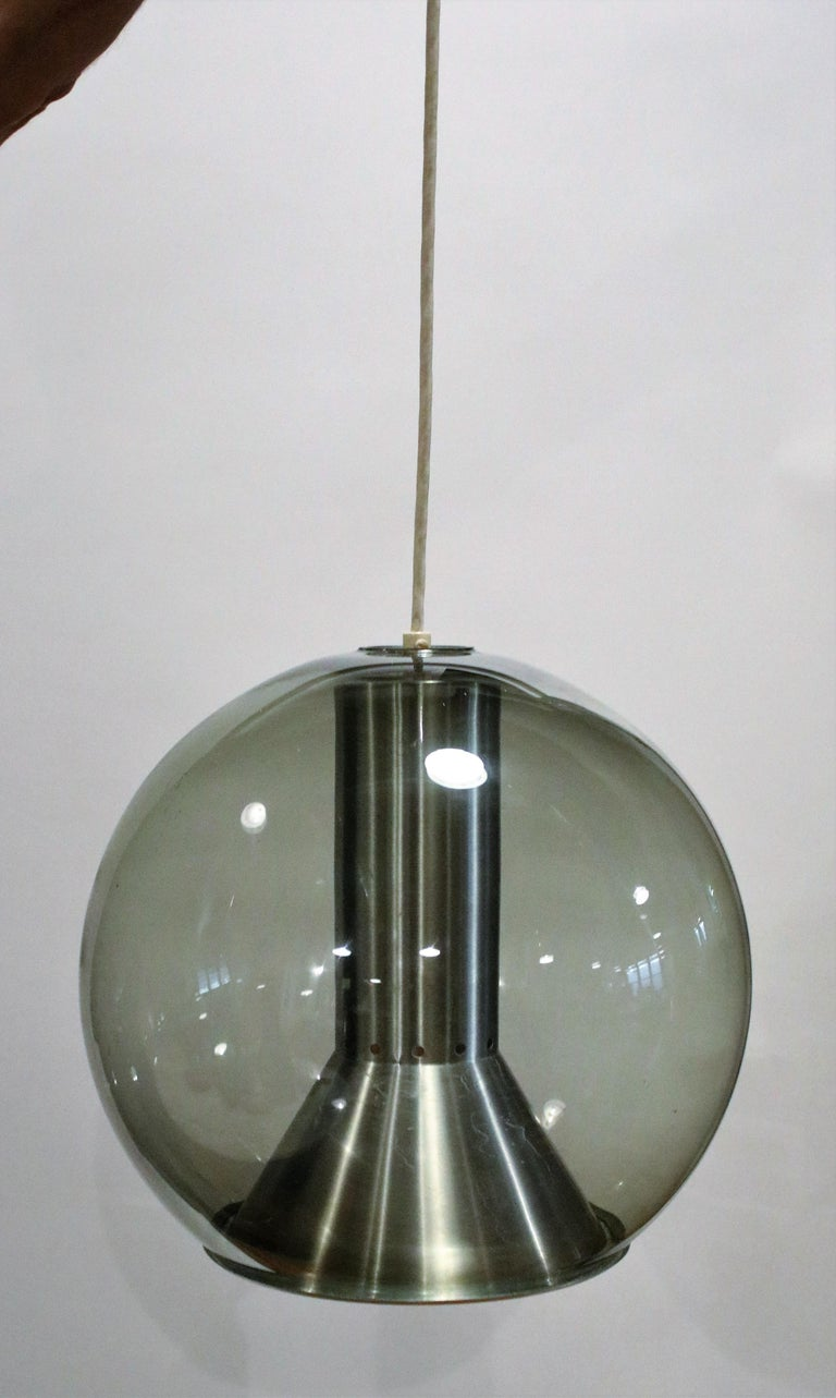 Smoked glass model B 1040-20globe ceiling lamp by Franck Ligtelijn for RAAK, Amsterdam 1960s, wired and working.