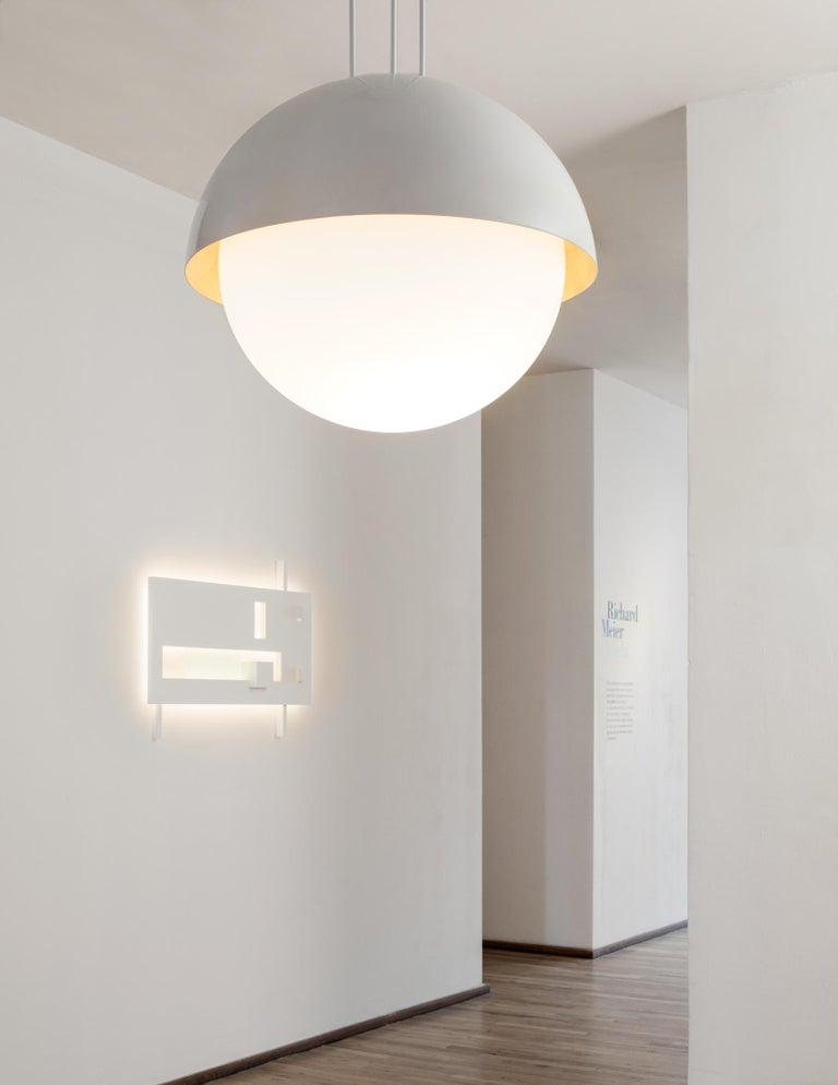 Part of the Cycladic Series. Generously proportioned dome chandelier in white powder-coated metal, with underside in fine gold or silver metal leaf appliqué. The Globe allows for two light settings. The main light source, a Murano glass globe
