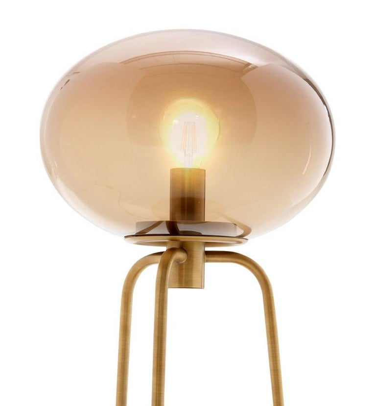 Infusing warm light on a desk in a study or nightstand in a bedroom, this table lamp will be a striking and elegant piece to showcase in any interior. The structure combines tonal colors, a timeless silhouette, and elegant finishes with the