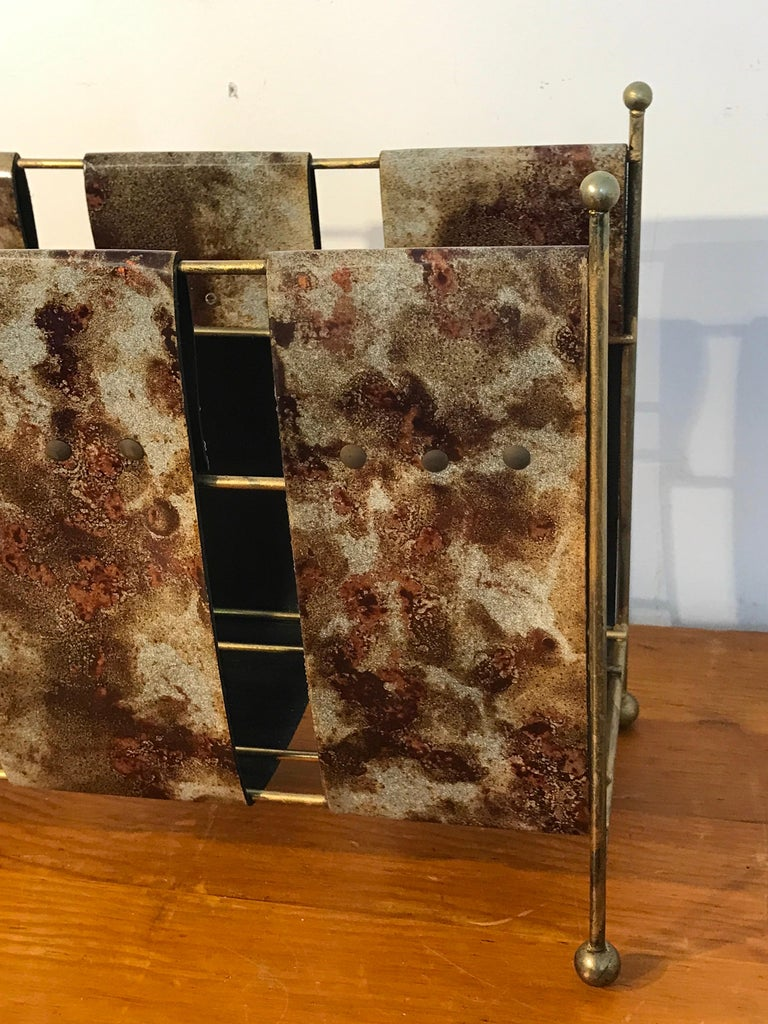 Goatskin Magazine Rack by Aldo Tura, with three goatskin lacquered straps, on a gilt metal stand. With an interior measuring 6.5