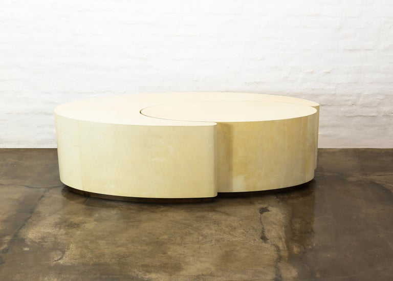 The Cadenza Nesting tables are handcrafted out of wood wrapped with geniune Argentine Goatskin, shown here in a natural finish, and can be pushed together to form one large oval, or moved around separately to create a dynamic composition. Available