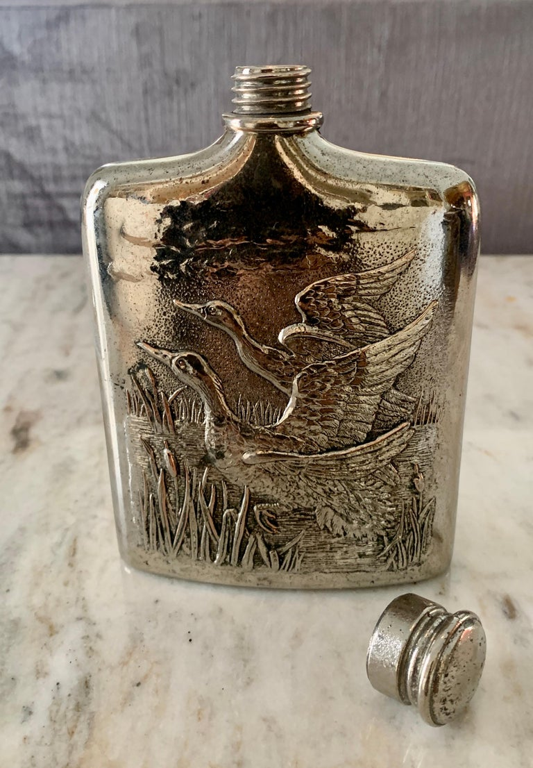 Godinger Flask with Reposse Geese and screw on Cap. The flask has been newly polished and is dated 1985. A wonderful decorative piece for the den or library, or for practical use