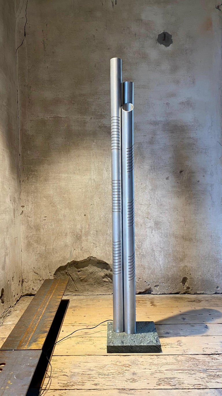 Goffredo Reggianichrome metal floor lamp for Reggiani Illuminazione, 1975.  Modern tubular floor lamp designed by Goffredo Reggiani for Reggiani Illuminazione, 1975. With a strong space age style, the three tubular chrome elements stand on a
