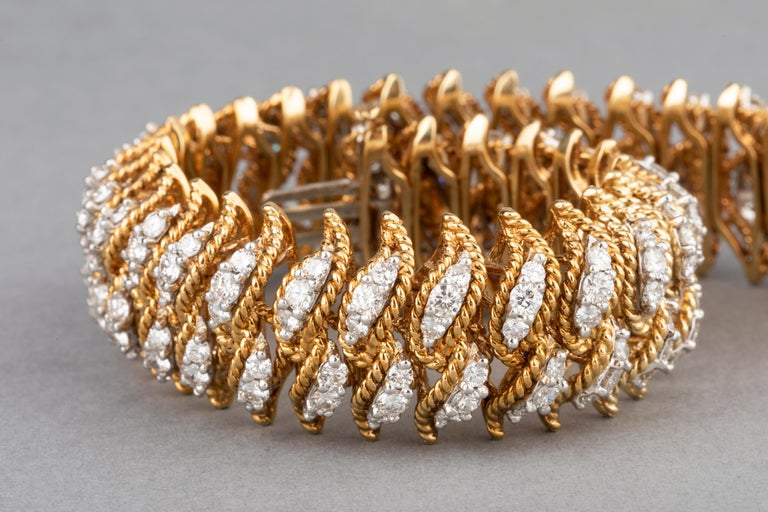 Very beautiful bracelet, made in France circa 1955.  The bracelet is heavy and has presence. It is spectacular.  The weight of the diamonds is 15 carats estimate of good quality, round  and brillant cut.  The weight of the bracelet is 91.30 grams.