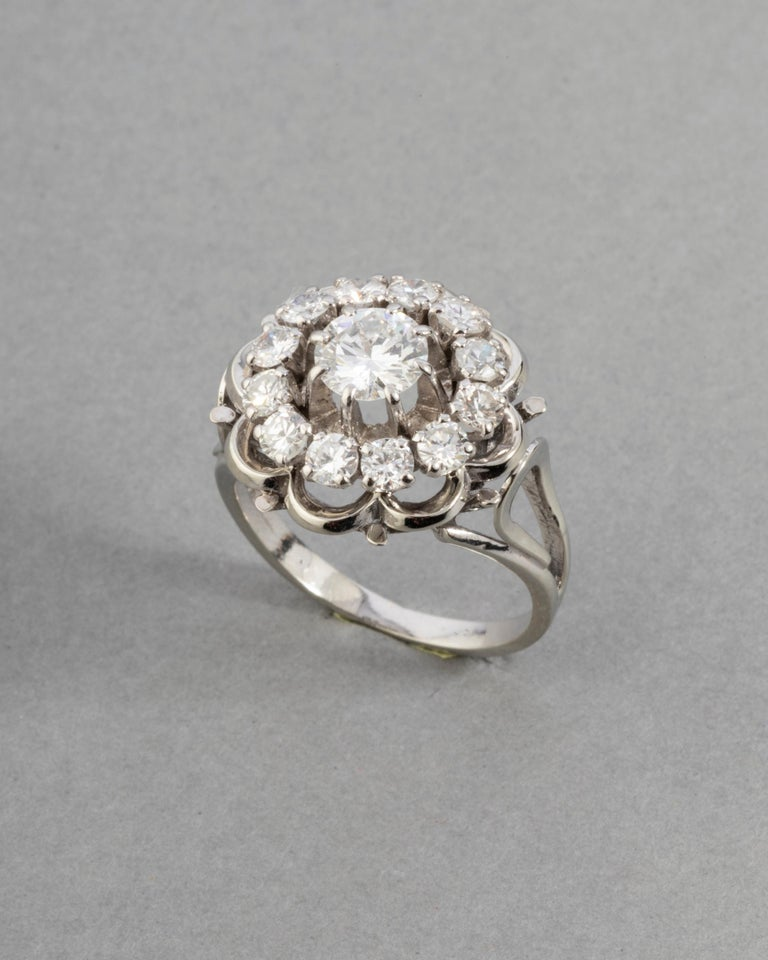 Gold and 1.60 Carats Diamonds French Vintage Ring  Very beautiful ring, made in France circa 1960. The principal diamond weight 0.60 carats, round brilliant cut. The quality is G/H color estimate, very white, and VS1 clarity. French mark for gold