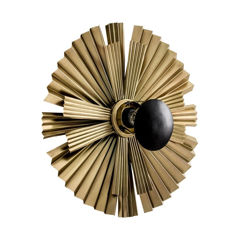 Goldand black lacquer finish metal wall lights composed of an aerial and round metal structure.