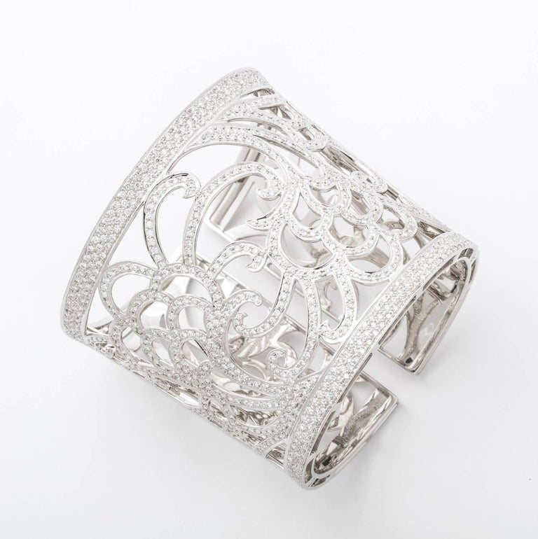 18 Karat white gold and diamond tapered cuff bracelet containing 500 full cut diamonds total weight 7.33 carats.  121.7 grams 18k gold,  Hand pierced and and set in a beautiful floral pattern
