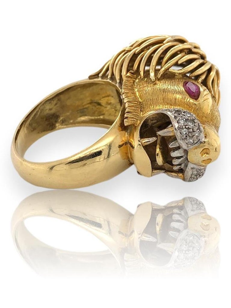 1970's Leo Zodiac ring. 18k Gold Lion head ring with ruby eyes and a diamond muzzle. The 1 1/8
