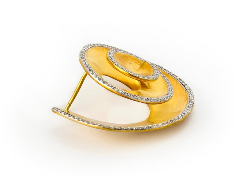 Gold and diamond earring is a Nautilus design by Umrao.