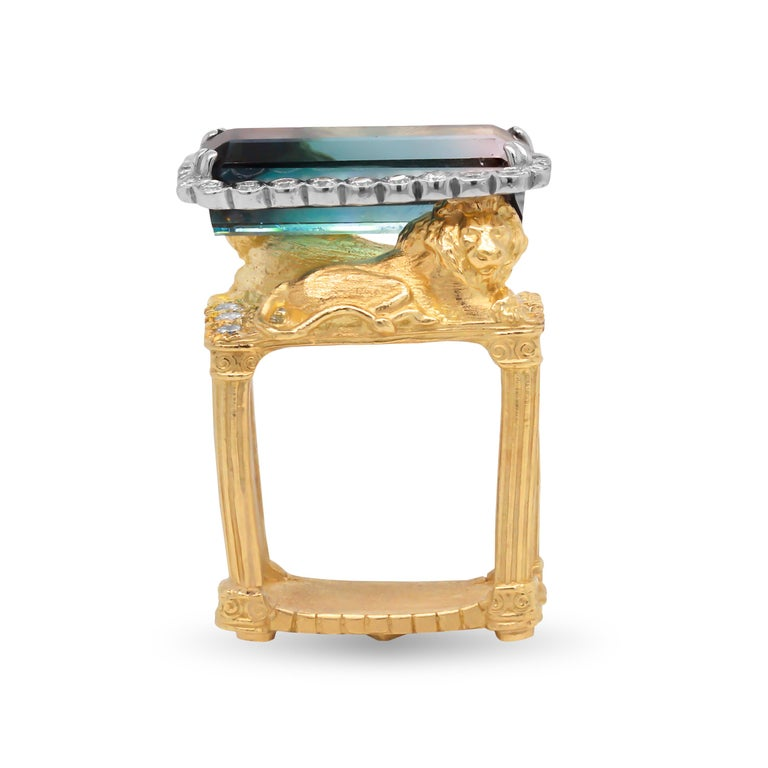 18k Two Tone Yellow White Gold and Diamond Ring with Bi Color Tourmaline Center by Stambolian  This ring features two Lions holding the Bi-Color Tourmaline center. A ring titled the