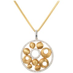 Gold and Diamond Round Pendant Necklace