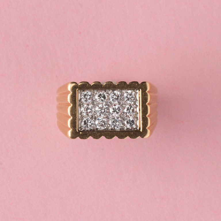 An 18 carat yellow gold rectangular tartelette ring set with 12 brilliant cut diamonds (app. 0.6 carat in total), the shank of the ring has a ribbed motif and had a slight slope, signed and numbered: Van Cleef & Arpels, 67342.  weight: 14.58