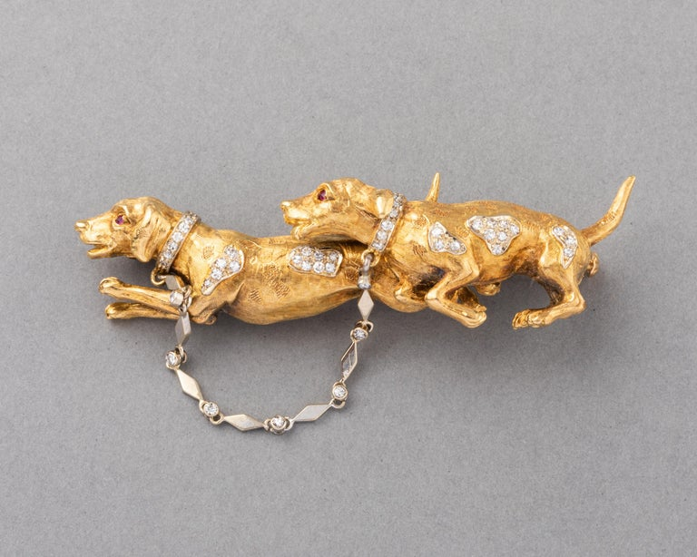 Very beautiful brooch, European made circa 1960.  Made in yellow gold 18k and set with diamonds.  There are hallmarks for gold, signature (unknown).   The two dogs are very cute. The design and workmanship is quality.  Dimensions: 6.3 cm length and