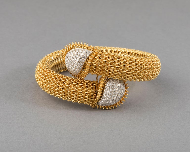 Gold and Diamonds Vintage Bracelet  Very beautiful bracelet, European made circa 1955. It is heavy, 124 grams, gold 18k. Mark for gold 18K. The diamonds weights 1.5/2 carats estimate. The width is 13mm, the length is for every size / elastic. it