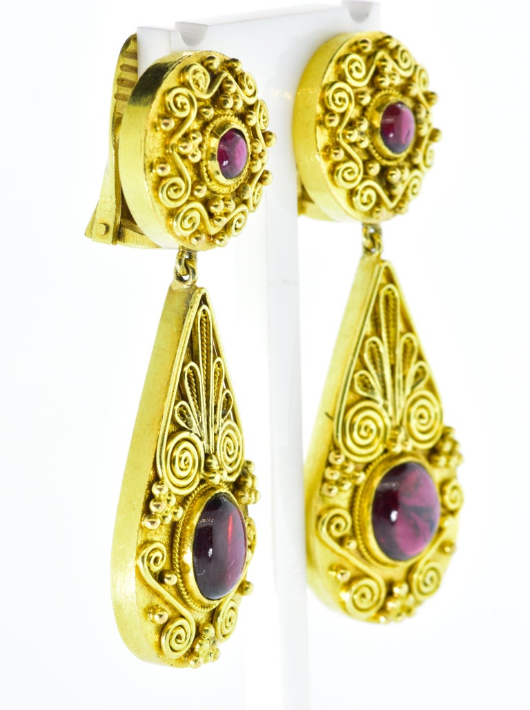 18K and 4 natural deep Burgundy garnet earrings which are highly decorated with bead and wire work, referred to as Etruscan Revival.  These earrings are easy to wear and now for a non pierced ear but can easily be converted to accommodate a pierced