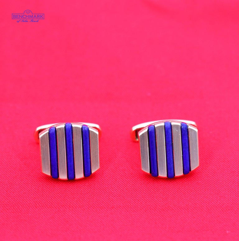 A pair of 18 karat yellow gold, cushion shaped, cufflinks, with each cufflink set with 3 lapis lazuli bars. The deep blue contrasts handsomely against the gold, and they measure just under 3/4 of an inch long. Signed A.B.L. they weigh an overall 20
