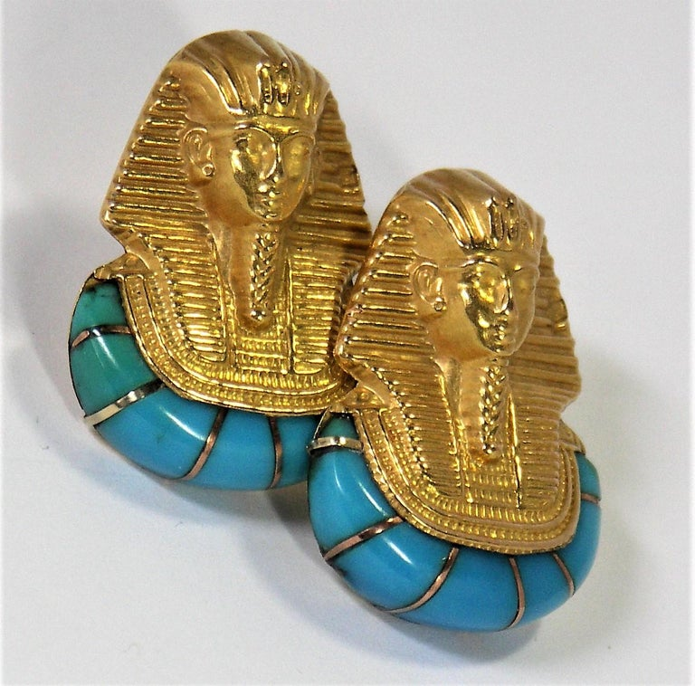 Made of 18K Yellow Gold and inset with 14 pieces of natural turquoise, these lightweight earrings will look great with the colors in your summer wardrobe. The Egyptian, pharaoh  motif is stylish and fun. They are set with posts and extra large push