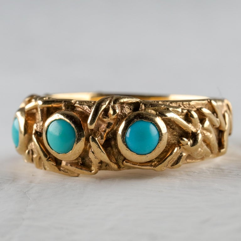 An exquisite, artistic heavy 18K solid buttery yellow gold band is bezel-set with three pristine natural Persian turquoise gems in this one-of-a-kind hand-crafted ring with a definitely Art Nouveau vibe that dates from the 1960s. Fully hallmarked on